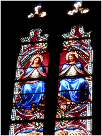 Stained window of Jesus and Mary Magdalene together as equals in local church.
